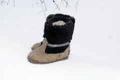 Russian traditional winter felt boot valenki on the snow Royalty Free Stock Photos