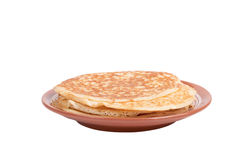 Russian traditional yeast crepes lying in the ceramic dish. Shal Royalty Free Stock Image