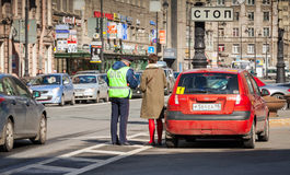 Russian traffic police inspector checks documents Stock Images