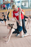 Russian trainer coaches girls gymnasts Stock Images