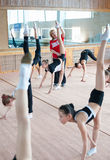 Russian trainer trains girls gymnasts Royalty Free Stock Image