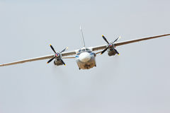 Russian transport turboprop aircraft AN-26. Russian military transport turboprop aircraft AN-26 in the cloudy sky Royalty Free Stock Photography