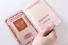 Russian Traveling Passport in hand. Royalty Free Stock Image