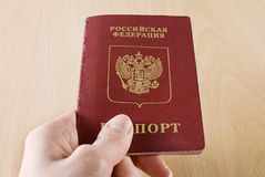Russian Traveling Passport in hand. Stock Photography