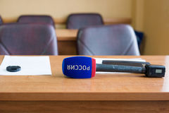 Russian TV channel microphone on the table Royalty Free Stock Photo