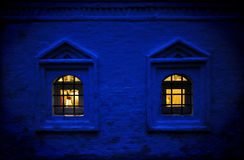 Russian Twilight with Warm Windows in Traditional Cottage Stock Image