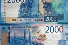 Russian two thousandth notes close-up against the background of a dark wooden table. Russian two thousandth notes close-up stock photos