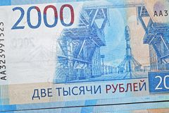 Russian two thousandth notes close-up against the background of a dark wooden table. Russian two thousandth notes close-up royalty free stock photo