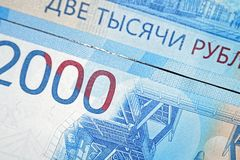 Russian two thousandth notes close-up against the background of a dark wooden table. Russian two thousandth notes close-up stock images