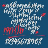 Russian and Ukrainian calligraphic alphabet. Contains lowercase and uppercase letters, numbers and special symbols. Russian and Ukrainian calligraphic alphabet Royalty Free Stock Photos