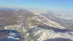 Russian Ural mountains in winter. Aerial view lake, white infinity. Russian Ural mountains in winter. Aerial view of the lake and the endless landscapes stock footage