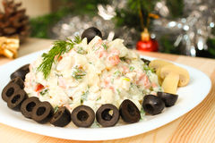 Russian vegetable salad with mushrooms on New Year Eve Royalty Free Stock Photo