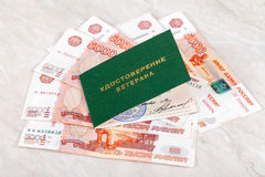 Russian Veteran Certificate lying over banknotes Royalty Free Stock Photo