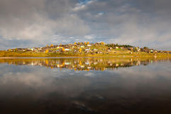 Russian village on a hill over the river Royalty Free Stock Images