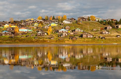 Russian village on a hill over the river Royalty Free Stock Image