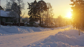 Russian village landscape. Road in the snow during a stunning sunset. Nature. Stock Images