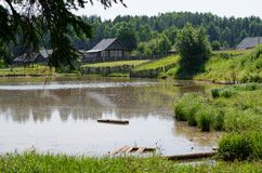 Russian village on the shore of the pond. Russia, The Urals. Sum stock photo