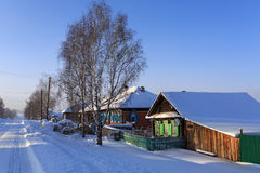 Russian village Visim in winter. Ural region, Russia. Snow-covered russian old believer village in frosty sunny winter day Royalty Free Stock Images