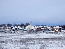 Russian village in winter in Suzdal royalty free stock image