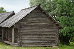 Russian village, wooden architecture, the house and the barn for storage of accessories Royalty Free Stock Photos