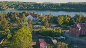 Russian village with wooden houses. Svir river and summer green forests of Leningrad region, Russia. stock video