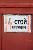 Russian Vintage Metal Sign - Stop, Danger High Voltage on the do Stock Photos