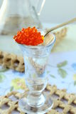 Russian vodka with a dollop of red caviar Stock Images