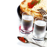 Russian vodka with pancakes and red caviar Royalty Free Stock Photography