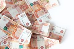 A heap / stack of Russian bills of five thousand rubles. Russian. The Russian way of storing money in a bank. Many bills of five thousand Royalty Free Stock Images