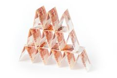 House of cards from Russian money. Pyramid from the bills. White. The Russian way of storing money in a bank. Many bills of five thousand Stock Photos