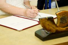 Russian wedding. Signature of documents in the registry office Stock Image