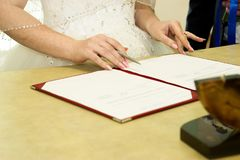 Russian wedding. Signature of documents in the registry office Stock Photo