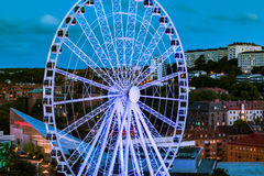 Russian wheel by dawn. A Russian wheel in Liseberg amusement park by dawn in Swedish summer.  The sky is bright but the window lights indicate it is late in the Stock Images
