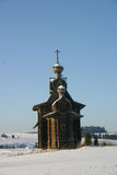 A Russian winter. Russian wooden cathedral of XVIII century Stock Image