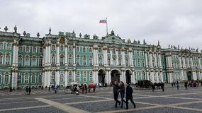 Russian Winter Palace in St. Petersburg, Russia with Russian flag royalty free stock photography