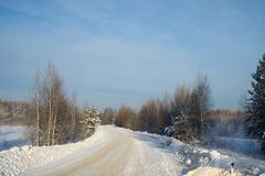 Russian winter road Royalty Free Stock Photo