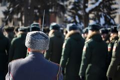 Russian Winter. A soldier with a bayonet in a karakul cap. Russian Winter. Parade. A soldier with a bayonet in a astrakhan cap Royalty Free Stock Image