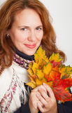 Russian woman with colorful autumn maple leaves Royalty Free Stock Photography
