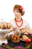 Russian woman drinking tea with samovar Stock Photos