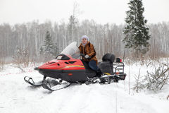 Russian woman driving snowmobile Stock Image