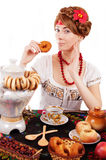 Russian woman eating traditional food Stock Image