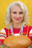 Russian woman in a folk dress royalty free stock photography
