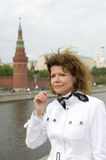 Russian woman and Moscow kremlin Stock Image