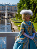 Russian woman in traditional costume. In front of Peterhof Palace and fountains. In St. Petersburg, Russia stock images