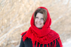 Russian woman with red knitted shawl on her head Royalty Free Stock Photography