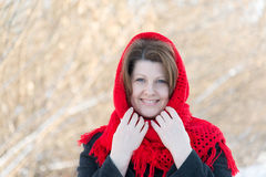 Russian woman with red knitted shawl on her head Stock Photography