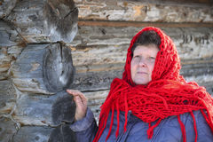 The Russian woman in  shawl warms hands near an Stock Image