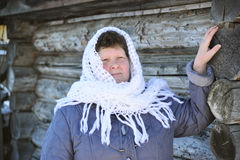 The Russian woman in  shawl warms hands near an Stock Photography