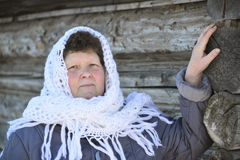 The Russian woman in  shawl warms hands near an Royalty Free Stock Photography