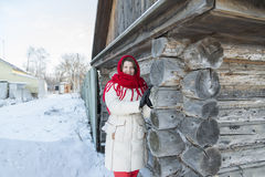 The Russian woman in  shawl warms hands near an Stock Photos